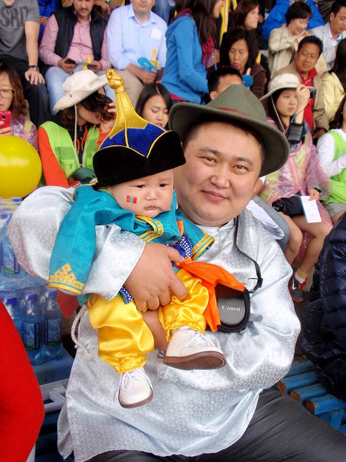 An infant dressed for the Naadam