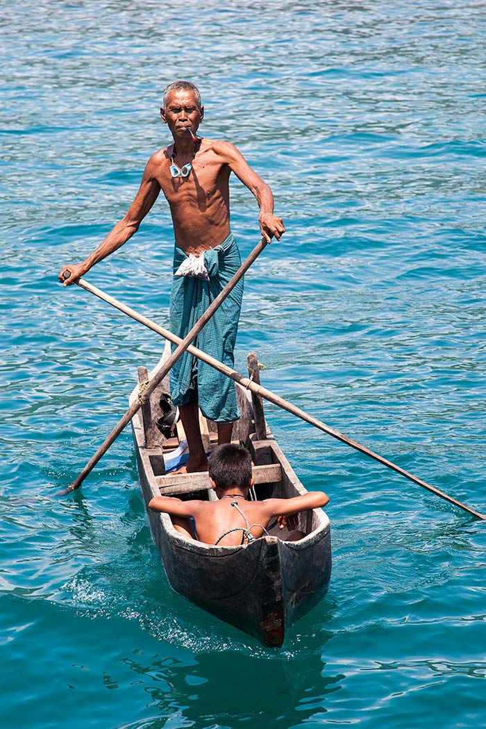 A Moken man on a traditional boat.