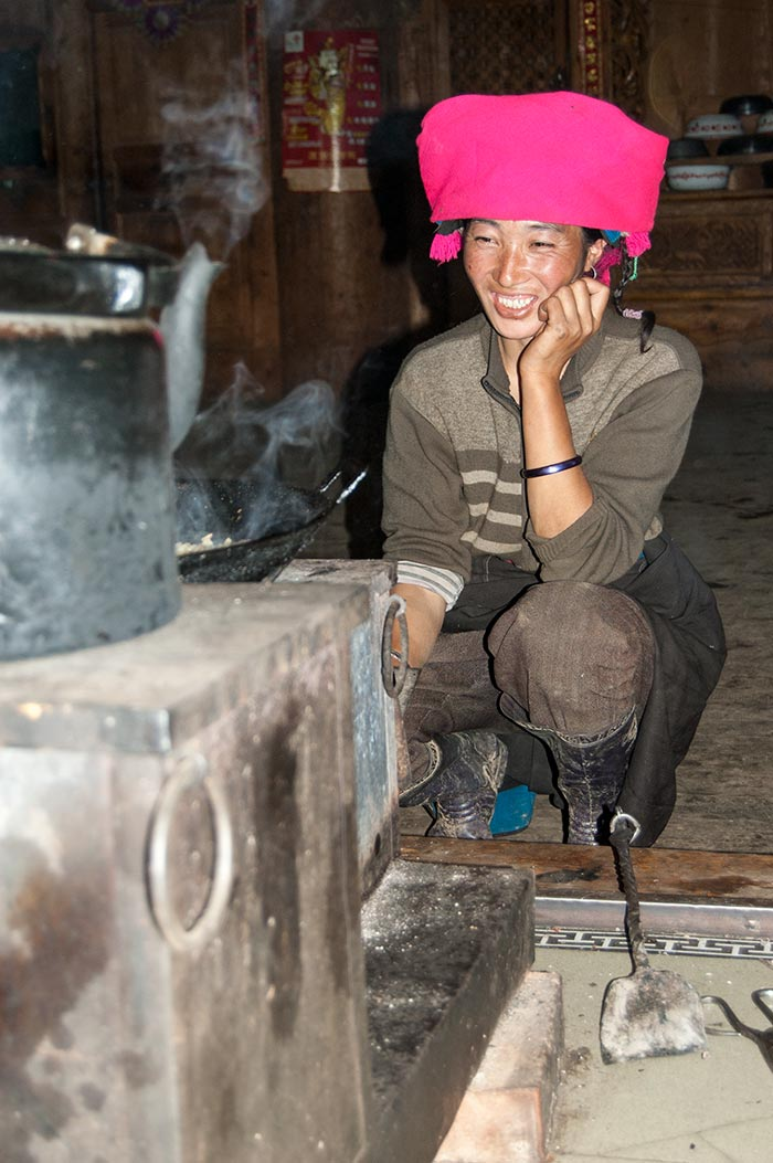 My friendly Tibetan host cooking dinner for me.