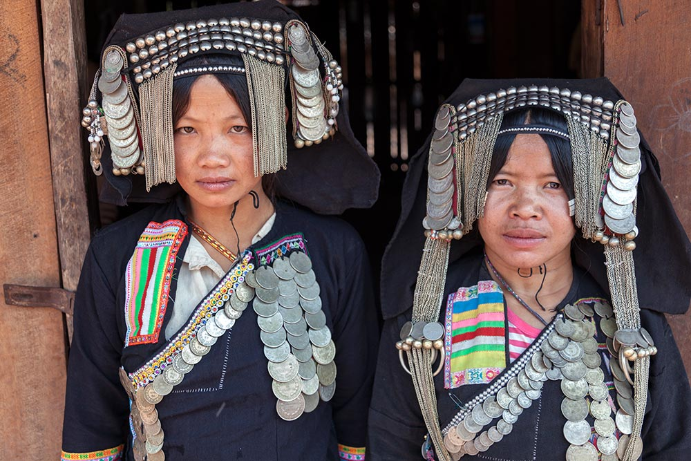 Two Akha Pusho girls who had never seen a foreigner or had their photo taken before.