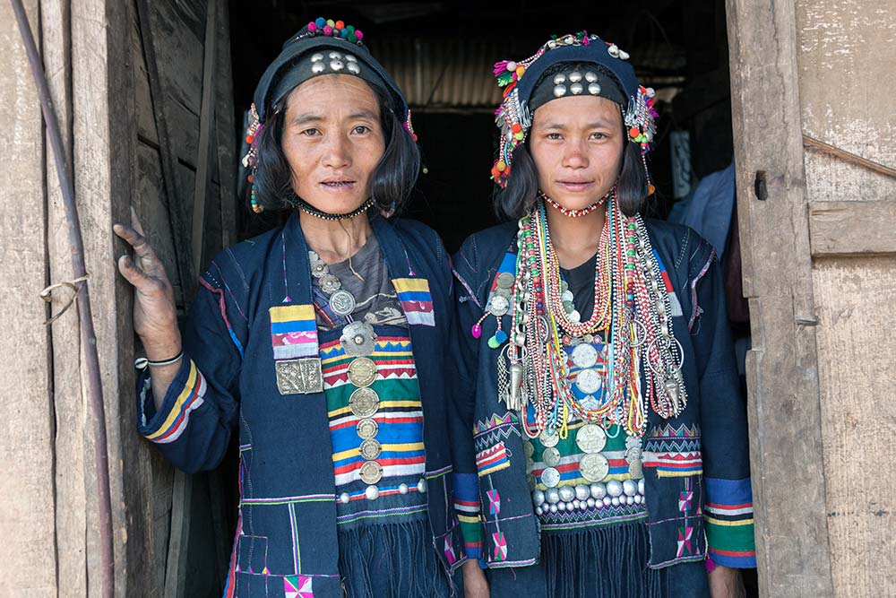 Two Akha Ghepia women having their photo taken for the first time.