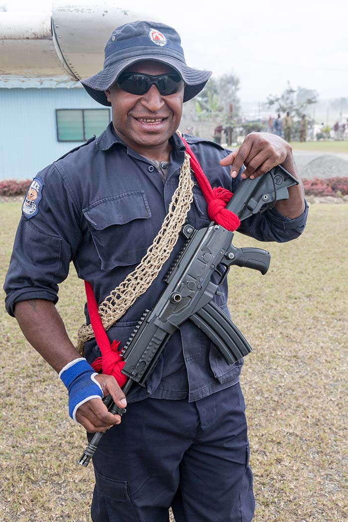 My security guard, holding his Galil assault rifle, was with me the entire time in Tari.