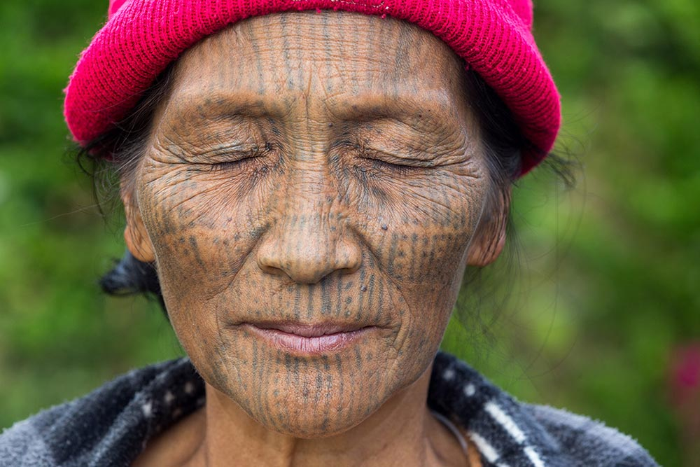 A Nga-Ya Chin woman shows us the tattoos on her eyelids, which she said hurt the most.