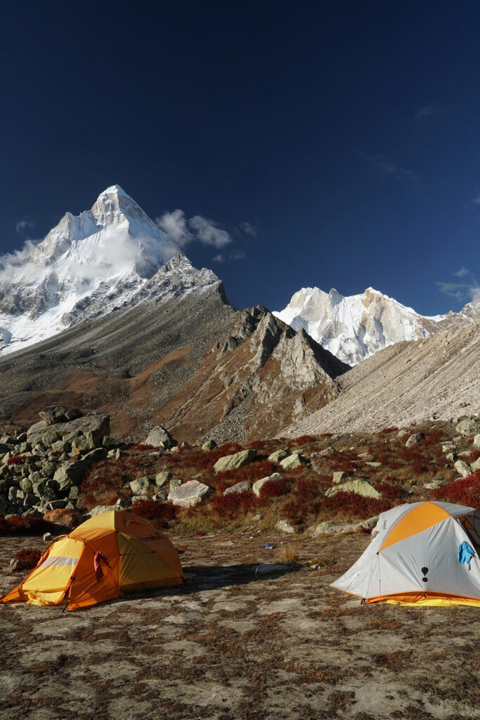 Our camp shows Shivling to the left, and the wide wall of stone in morning light, Meru, to the right sitting lower. Six days after this photo was taken two experienced Polish climbers died on Shivling.