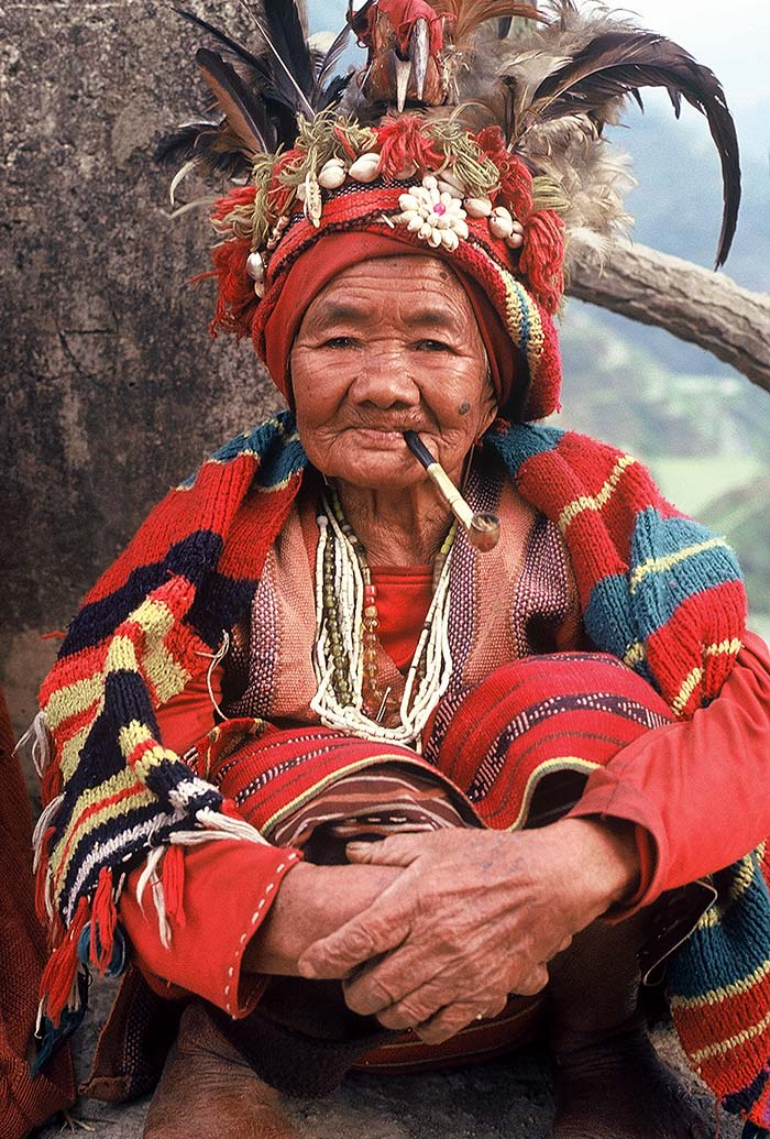 An Ifugao woman, in her 90's, wearing traditional clothing.