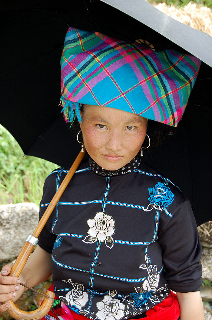 A young Flower Hmong girl returning from the market.