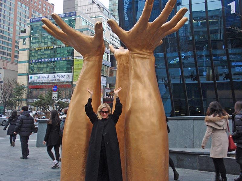 Catherine Heald raises her hands in Seoul