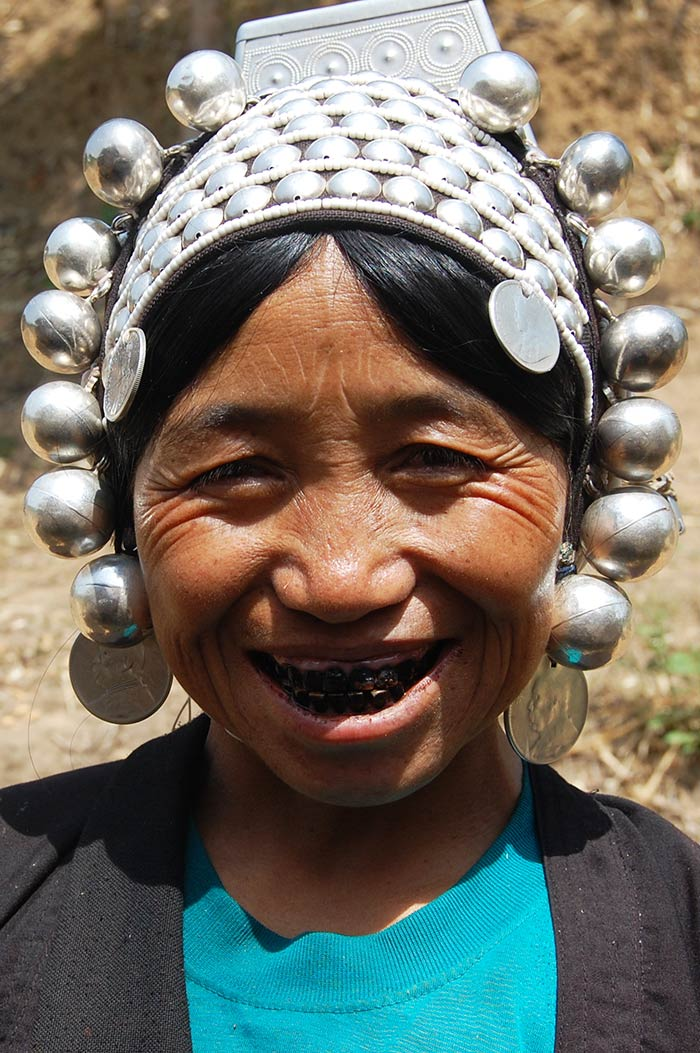 A friendly Akha woman, who was working in her field.