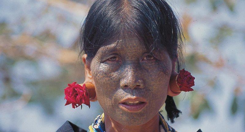 Tattooed Chin woman