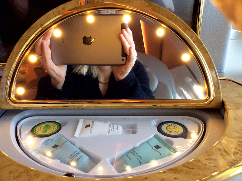 Private lighted make up mirror and amenities that pops open