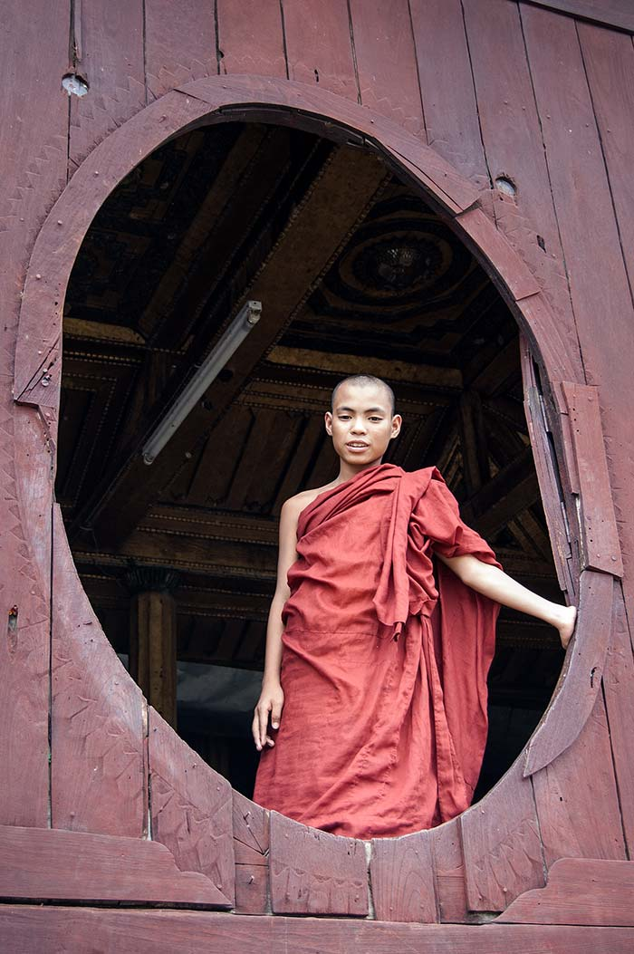 A young monk at the teak Shwe Yan Pyay Monastery.