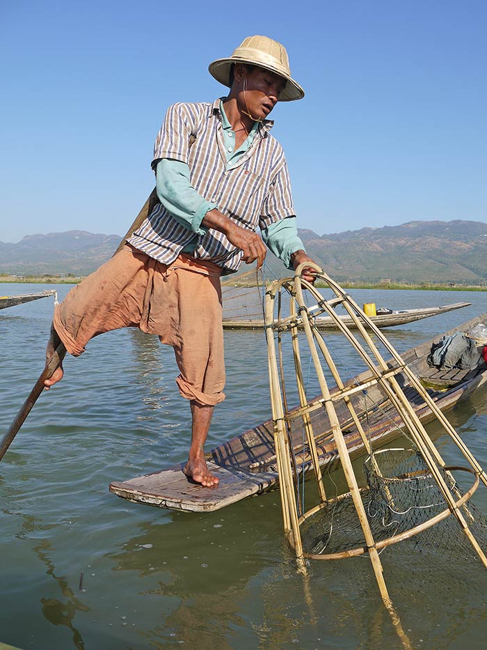 A friendly fisherman demonstrating how he catches fish.