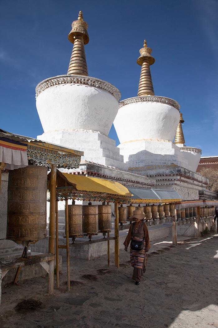 A pilgrims spinning the prayer wheels at Tashilhunpo Monastery