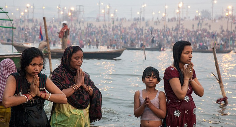 Worshippers celebrating Kumbh Mela with a dip in the Ganges