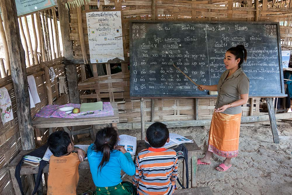 Hmong children learning to speak Lao.