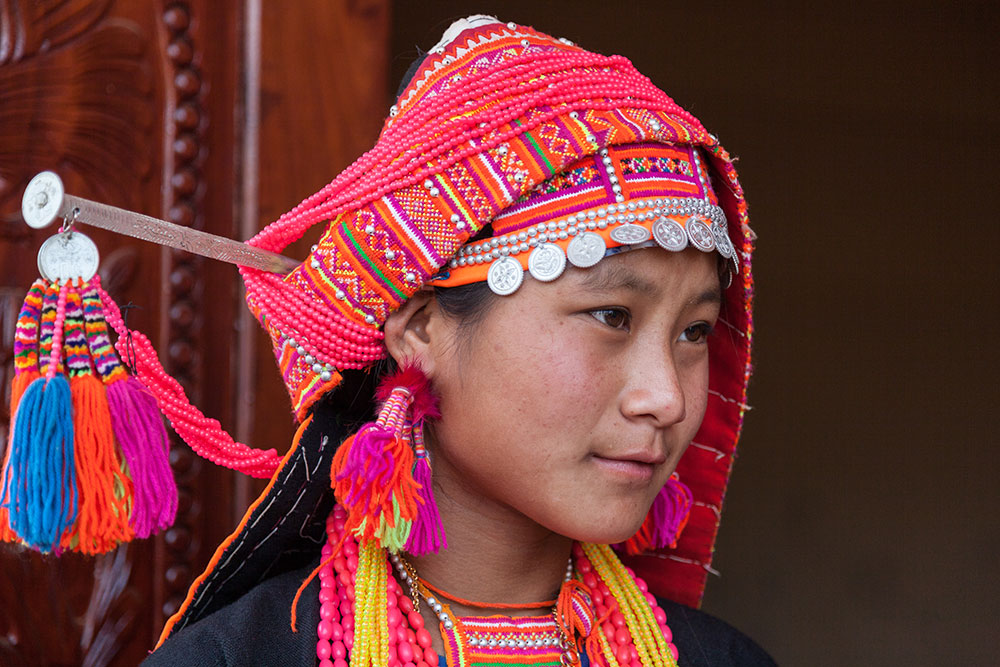 An Akha Loma girl in her traditional clothing.