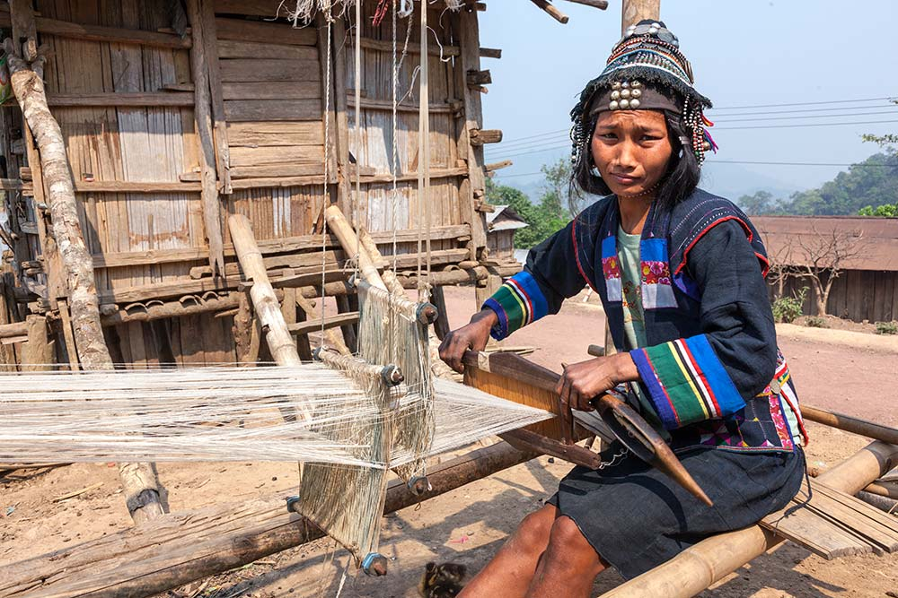 An Akha Ghepia woman weaving.