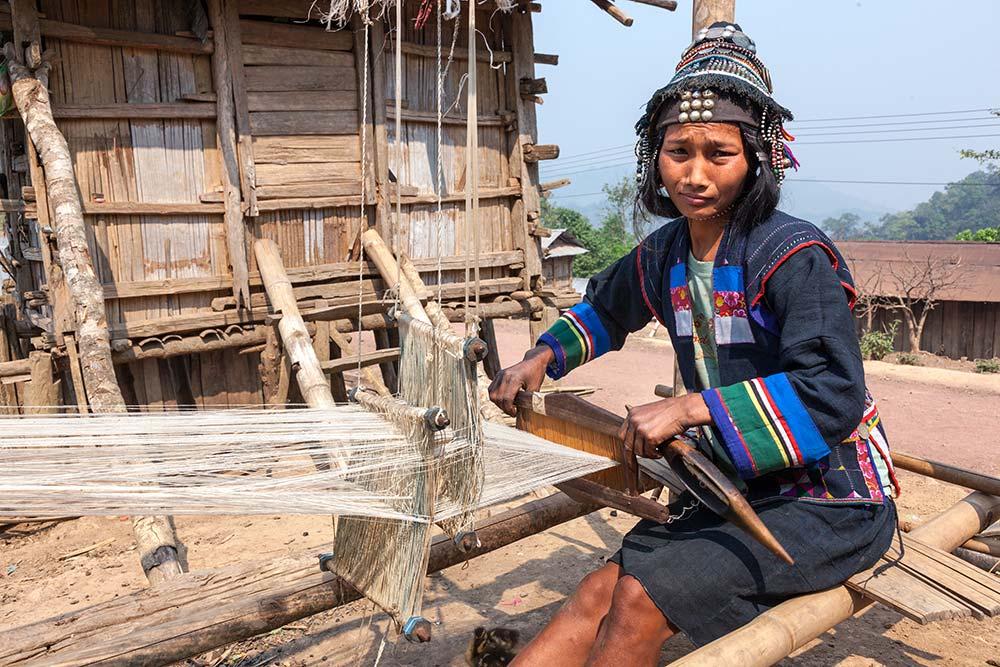 An Akha Ghepia woman weaving.