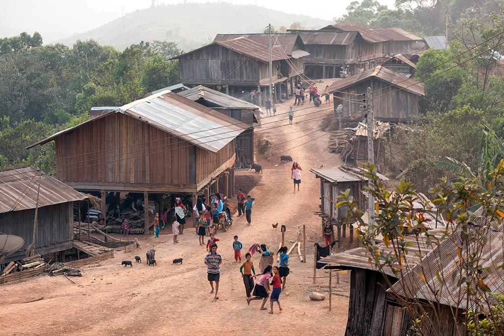 This Akha Ghepia village was buzzing with activity as the sun starting to go down.