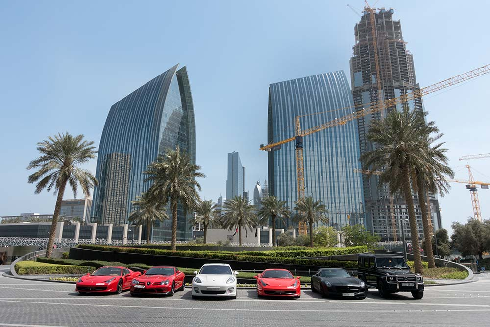 Luxury cars in front of the Burj Kalifa.