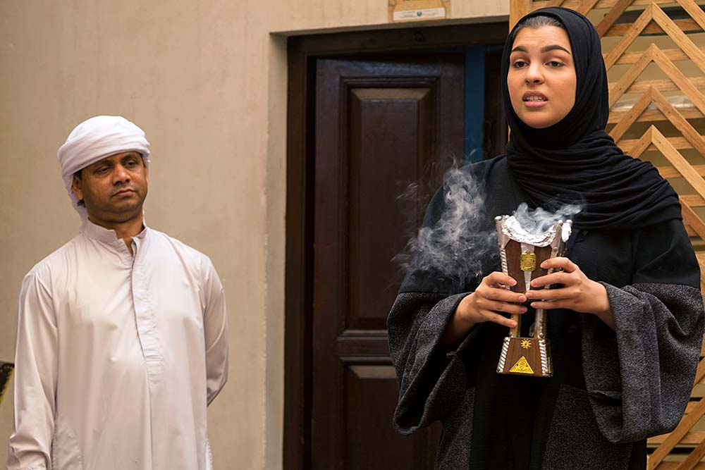 A university student discusses Emirati culture with us over breakfast.
