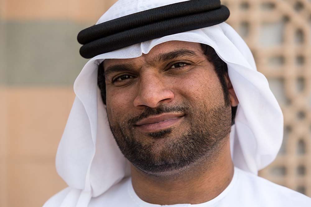 An Emirati man in wearing traditional clothes.