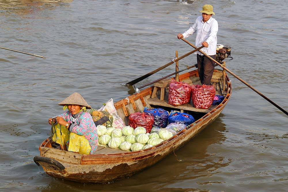 Numerous vendors came right up to our boat to try to sell their produce.