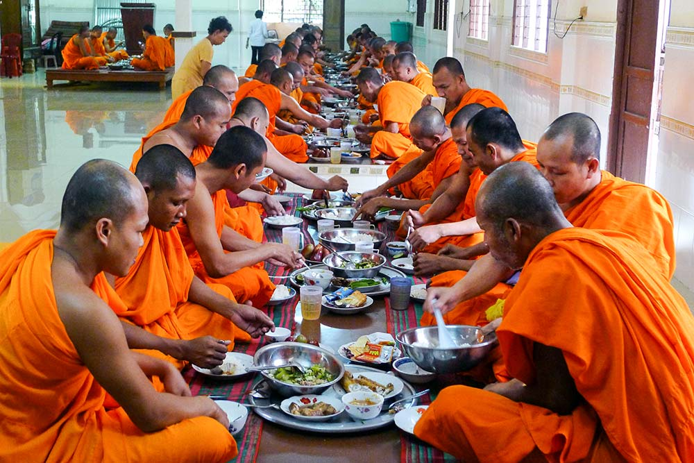 Monks eating their final meal of the day at 11am.