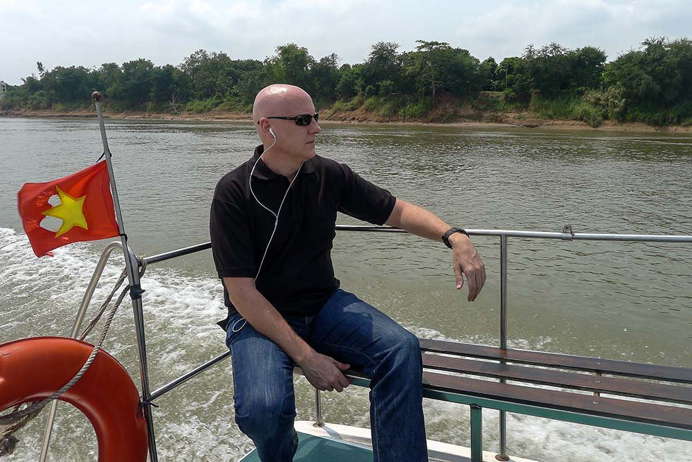 On the deck of the Blue Cruiser, watching the Cambodian countryside pass by.