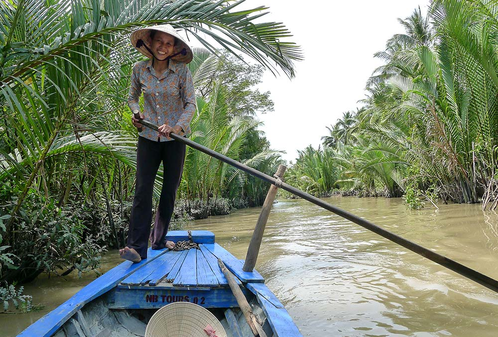 Our friendly sampan lady in rowed us through the narrow passageways of the Delta.