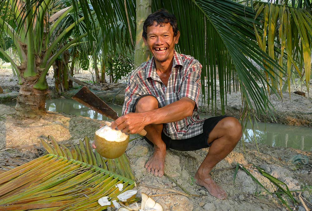 This coconut farmer was probably one of the happiest farmers I 've ever seen!