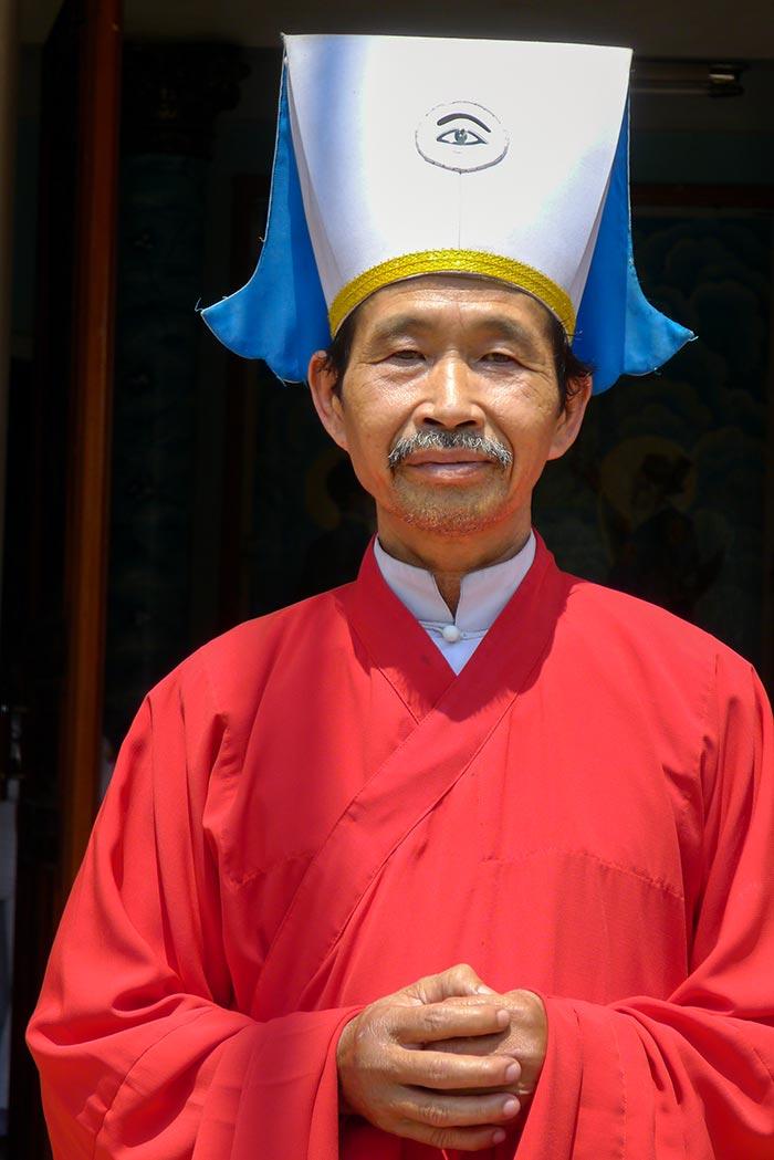 A Cao Dai priest.