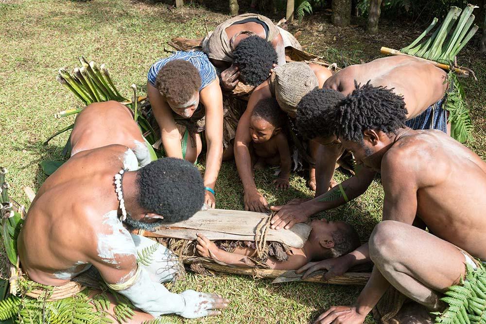 A mock funeral at Kolgngi village.
