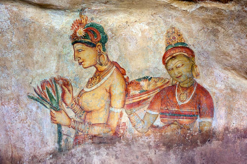 Ancient frescoes painted onto the side of the mountain can be seen on the way up Sigiriya.