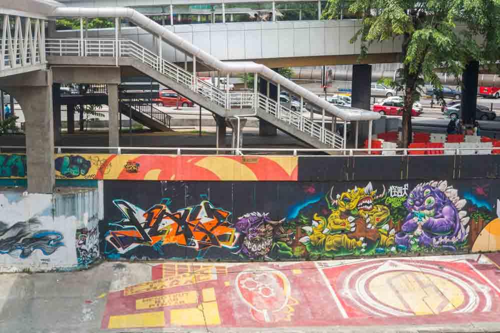 Urban graffiti along Klang Riverbank near Pasar Seni LRT Station