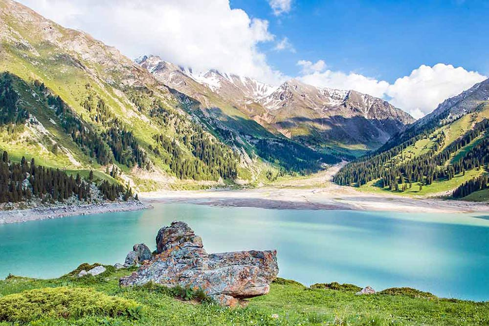 Turquoise mountain lake in Tien Shan mountains