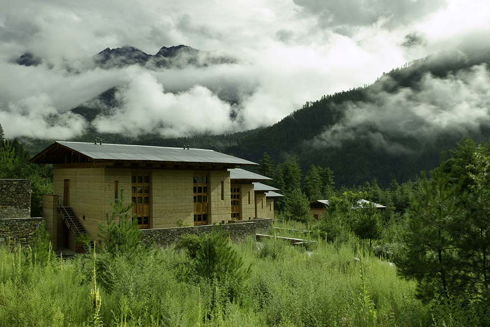 Amankora Paro-- a cozy library and a spa surrounded by woodlands.