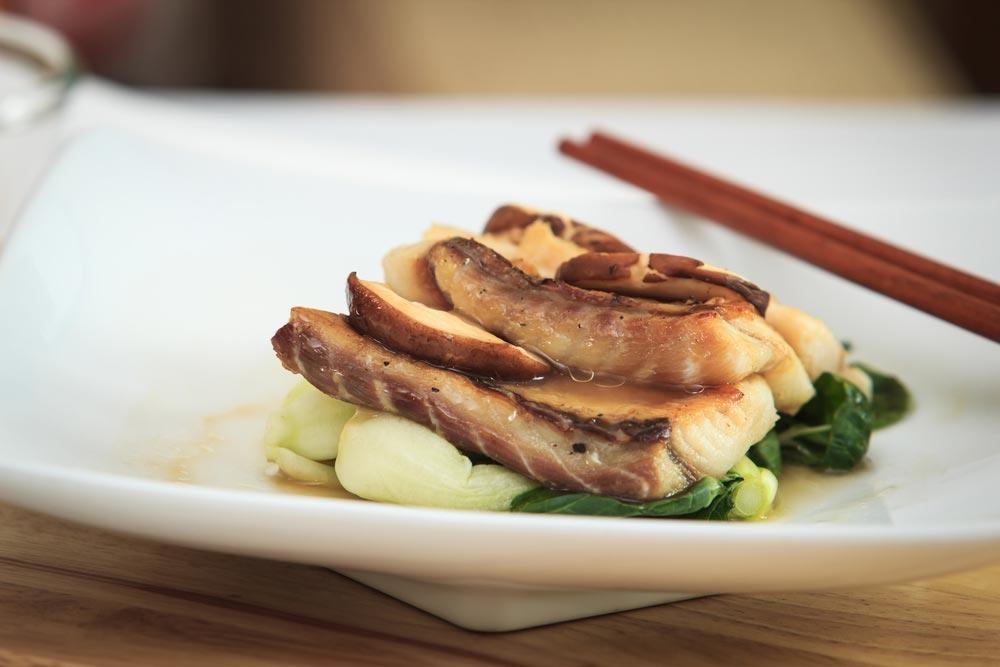 Fish fresh mushroom sauce served with vegetables.
