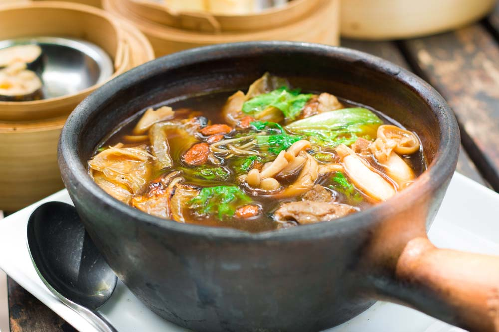 Bakuteh-a hearty broth of herbs and spices bubbling around meaty pork ribs.