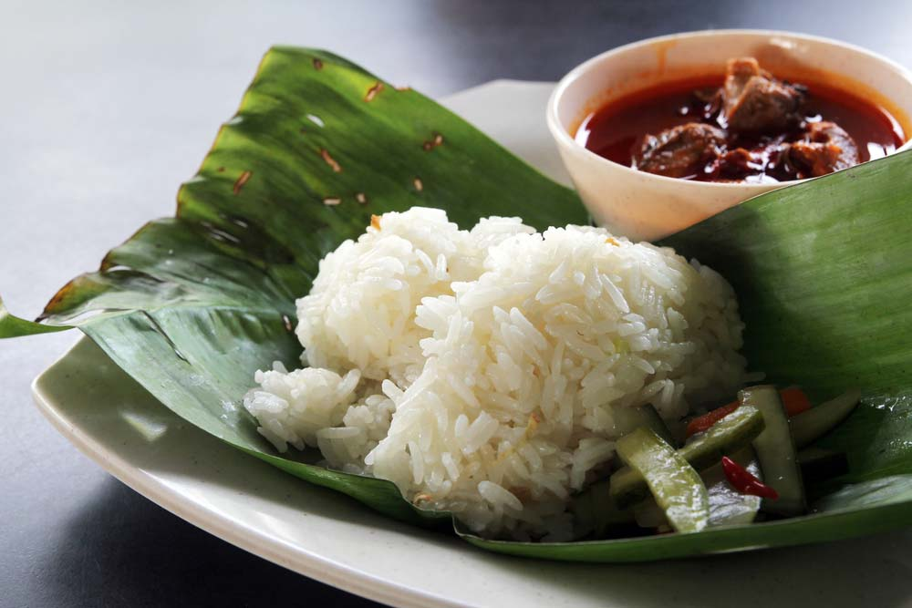 Nasi dagang, a Malaysian dish consisting of rice steamed in coconut milk and fish curry.
