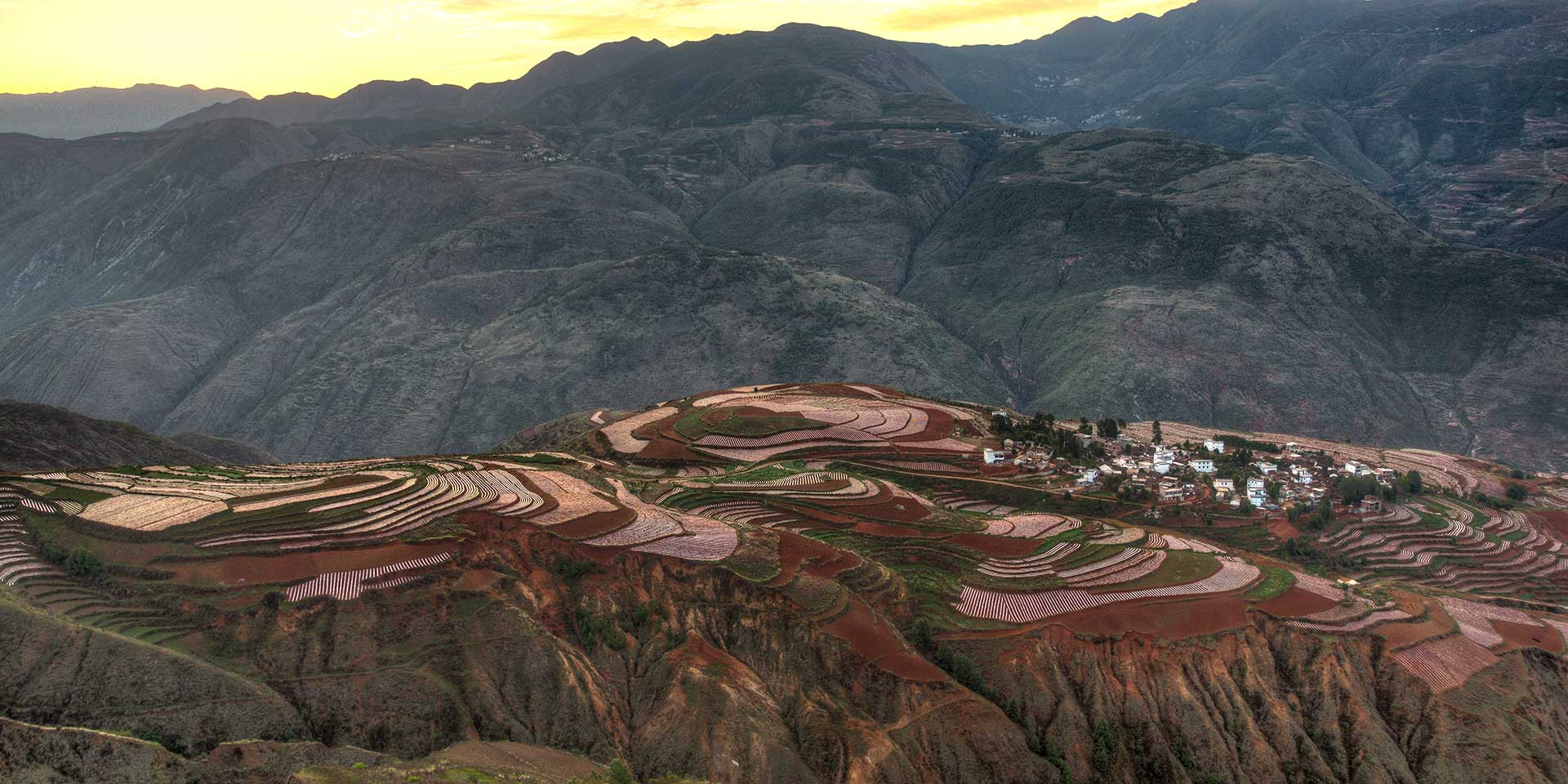 Red Soil, Greener Pastures: The Sun Sets in the Red Lands