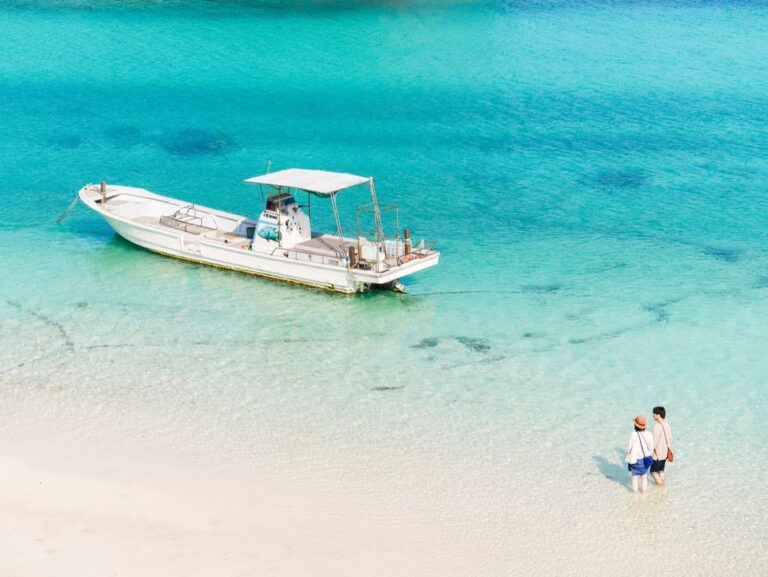 Boat and clear water beach on Ishigaki Island.