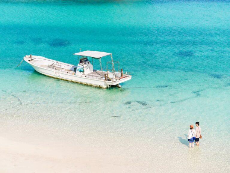 Boat and clear water beach on Ishigaki Island.